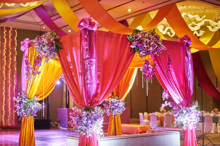 A colorful wedding tent covered in flowers