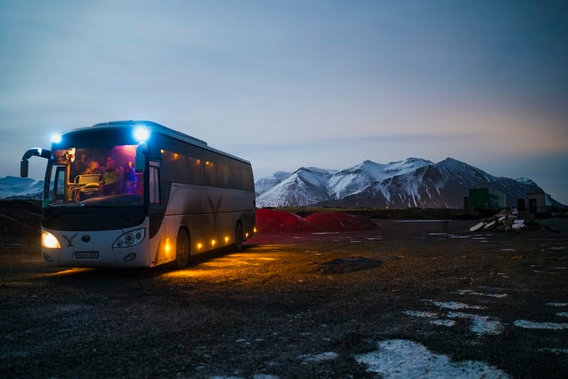 Bus with Iceland scenery and mountain