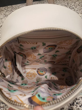 the baby yoda pattern on the inside of the backpack