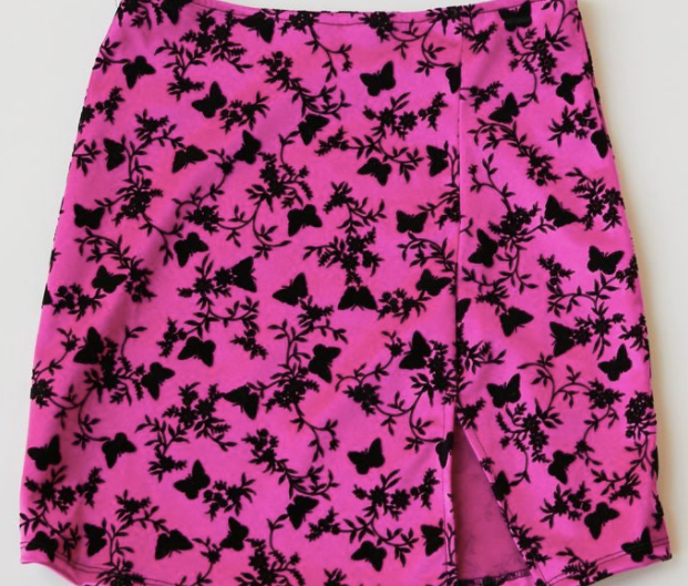 A hot pink mini skirt with a little slit on the side and black butterfly and flower details all over it