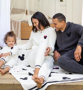 a family sitting on the blanket