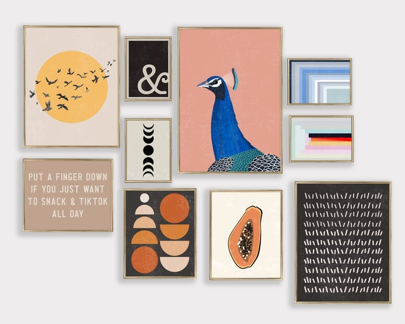 prints including small graphic and abstract designs, a peacock, a papaya, the sun with flying birds, and one that reads