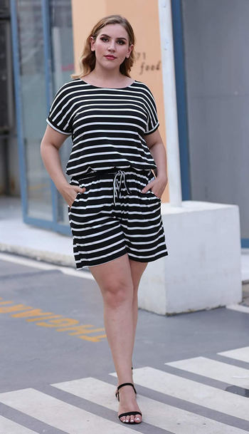 a model wearing the jumpsuit in black and white stripes