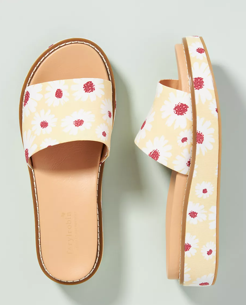 platform slide sandals in yellow with white daisies printed on them