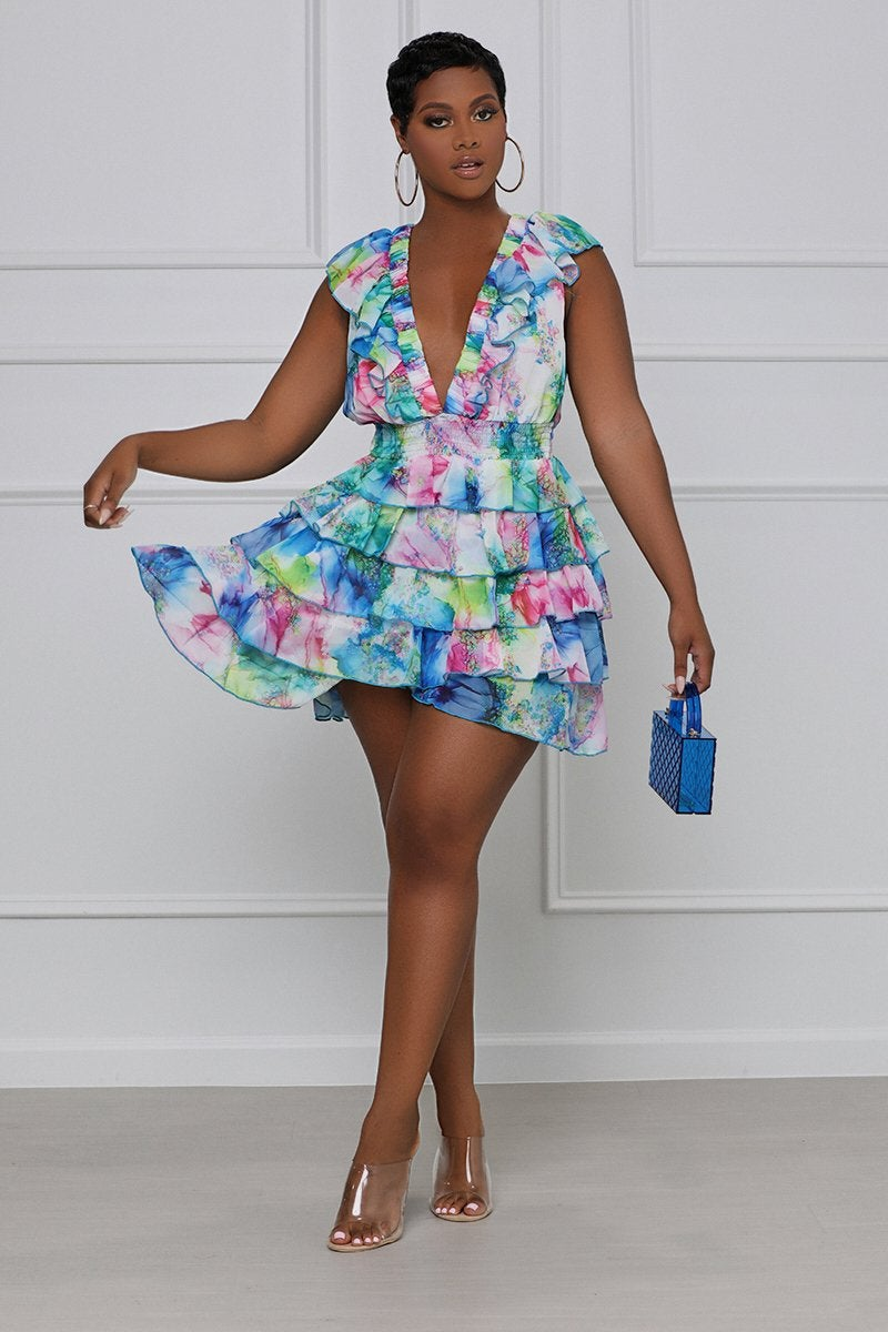 model in blue, green, and pink cap sleeve mini