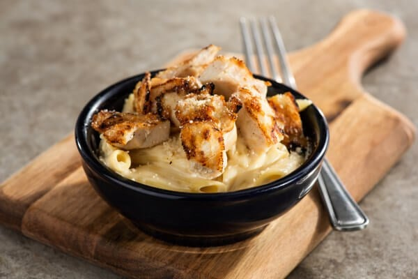 Penne pasta with grilled chicken on top