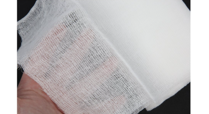 A white cloth with tiny squares that act as a sieve