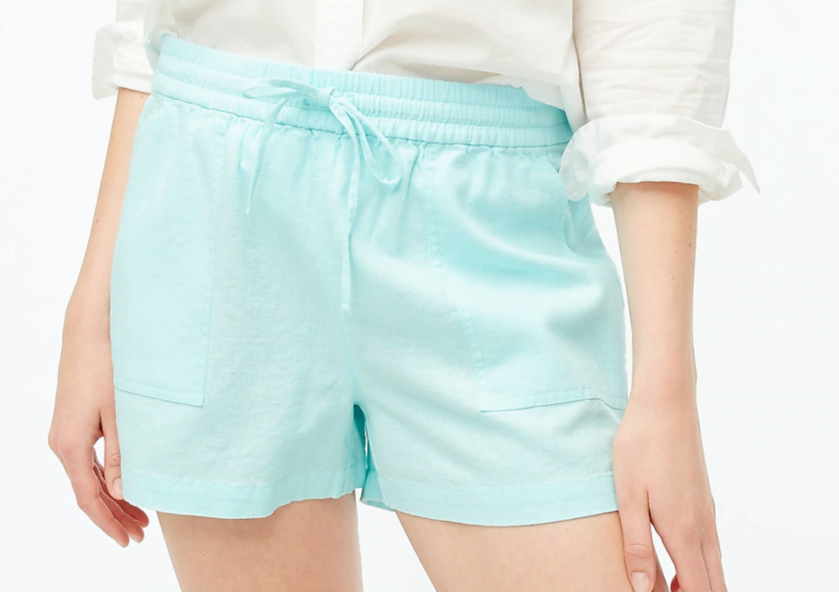 model wearing the shorts in teal