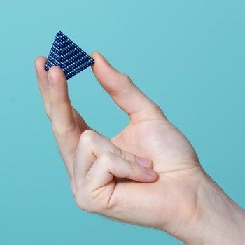model holding blue Speks