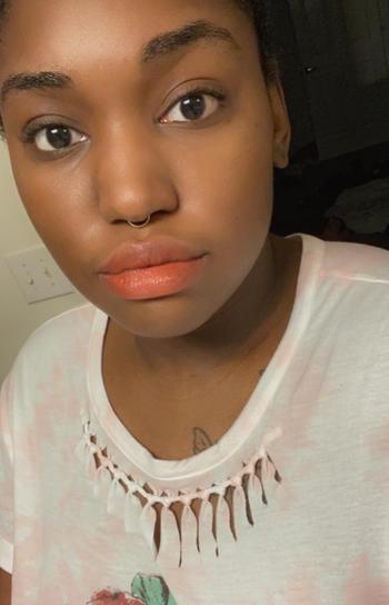 reviewer wearing a peachy orange shade
