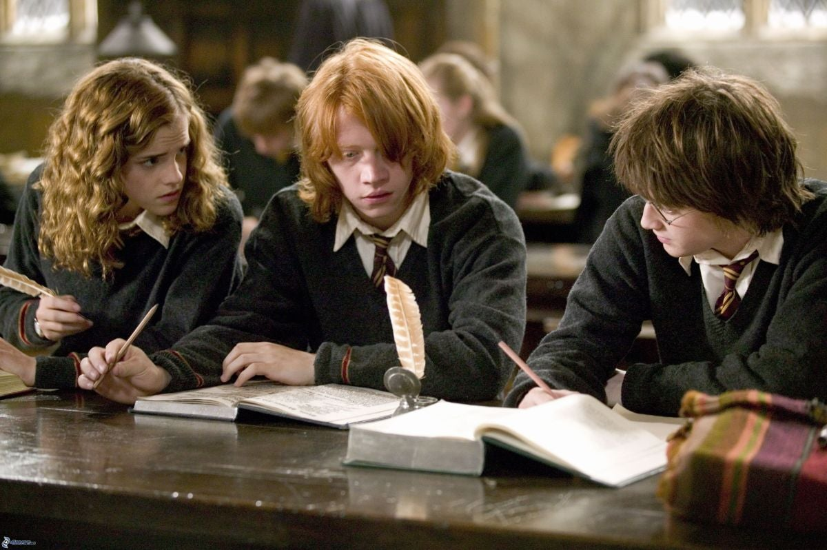 Harry, Ron, and Hermione look at their textbooks