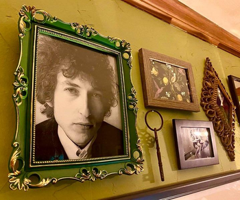 a reviewer photo of a gallery wall with the green frame hung up