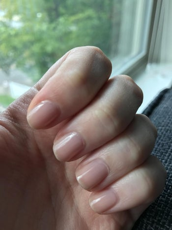 a reviewer with the polish on their nails