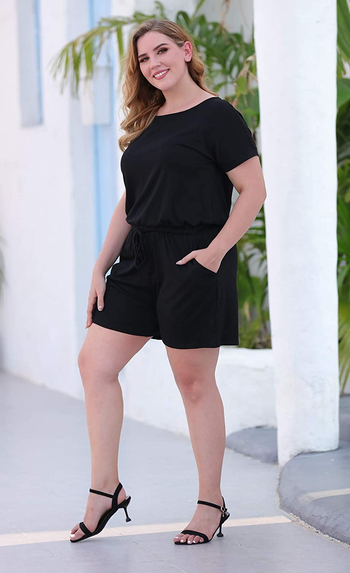 a model wearing the same jumpsuit in black