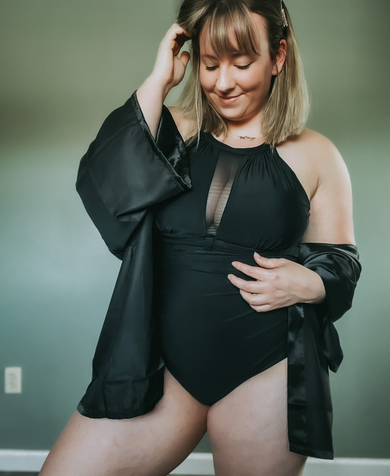 A reviewer in the swimsuit in black