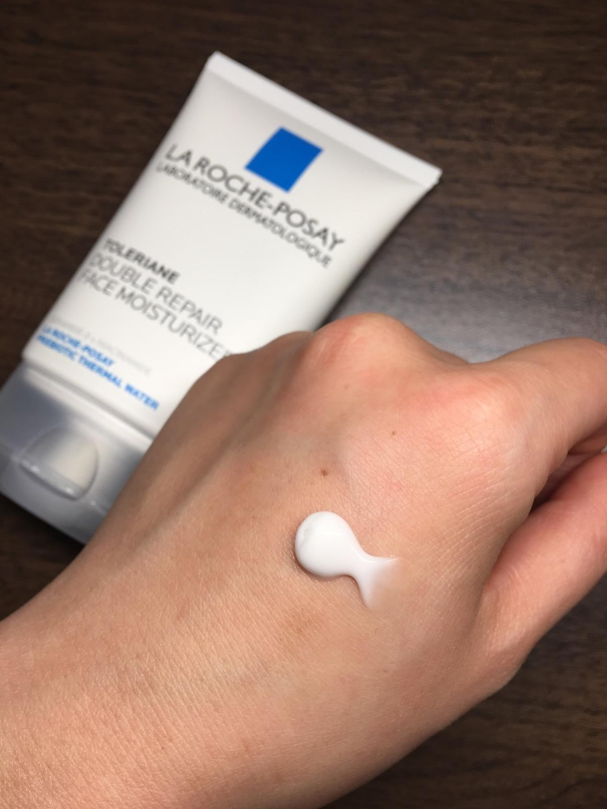 Reviewer with La Roche-Posay moisturizer on hand