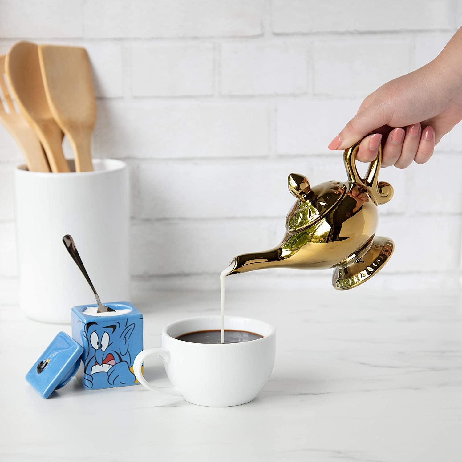 a square sugar bowl with the genie on it and a magic lamp filled with creamer