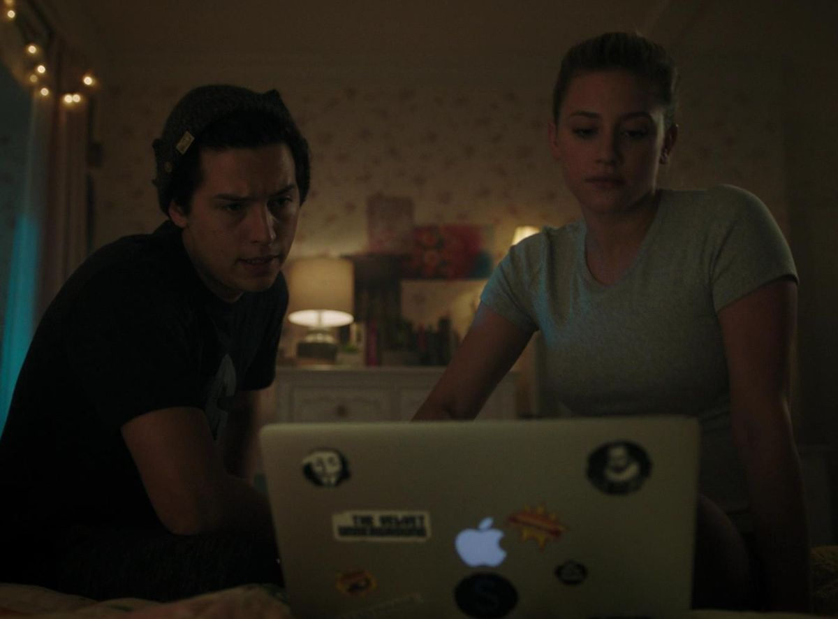 "Cole Sprouse as Jughead Jones and Lili Reinhart as Betty Cooper in the show ""Riverdale."""
