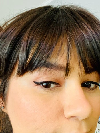 another reviewer showing off their crisp winged liner