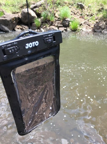 phone sitting inside a partially wet phone pouch