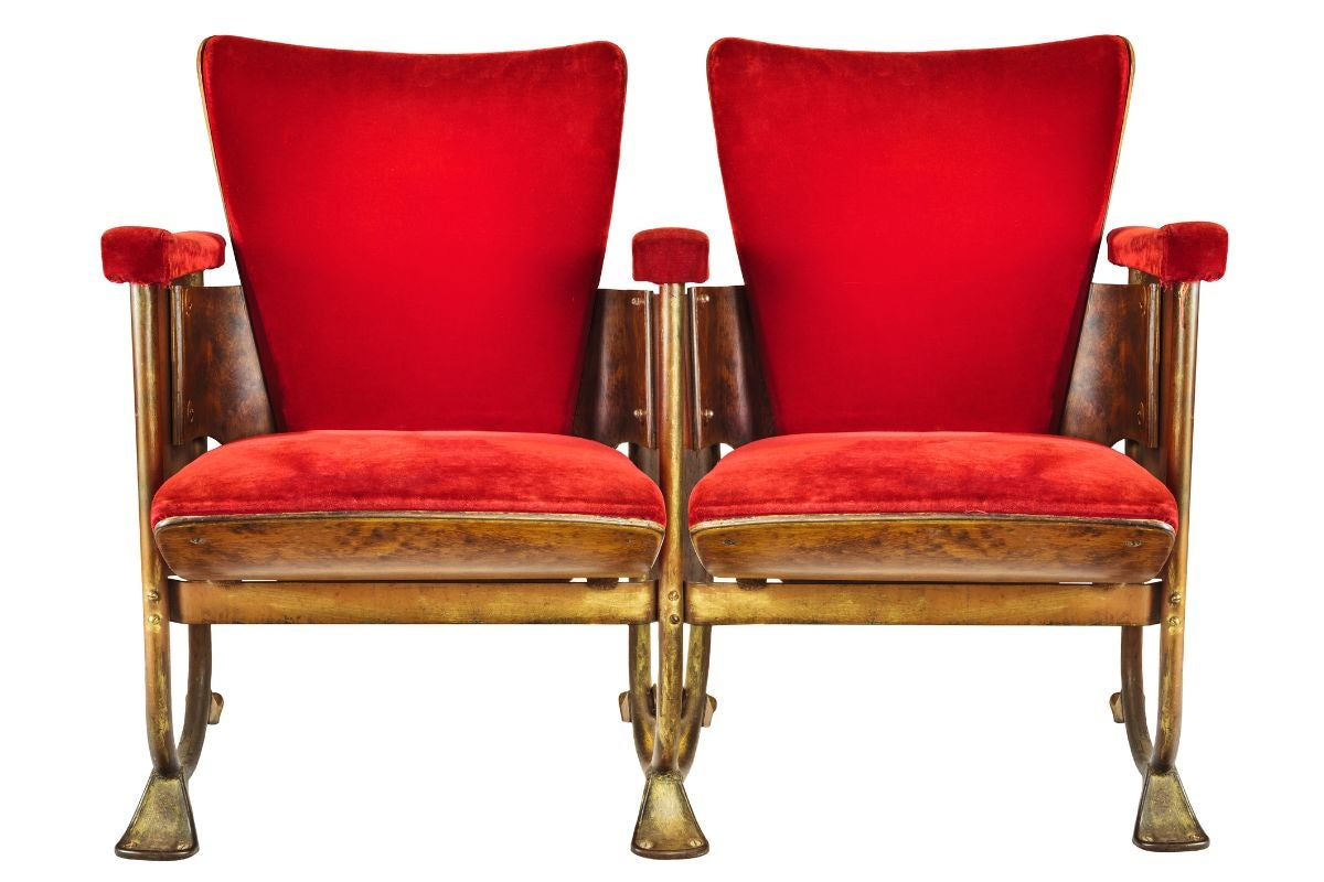 Velvet red chairs connected at the arm