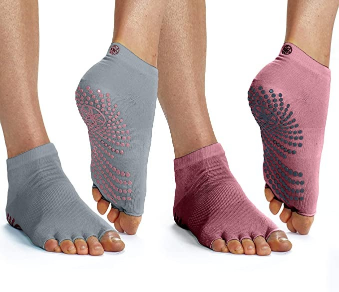 two pairs of feet with toeless socks with grips on the bottom
