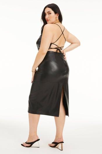 model wearing open back dress