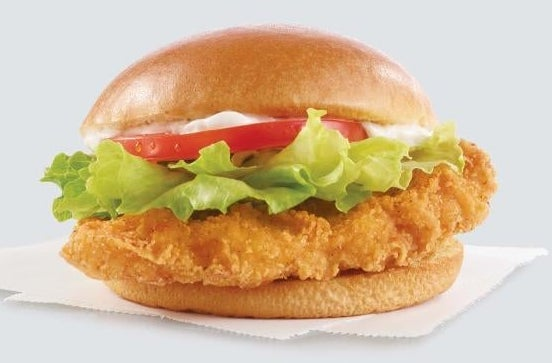 A crispy chicken sandwich with lettuce, tomato, and mayo