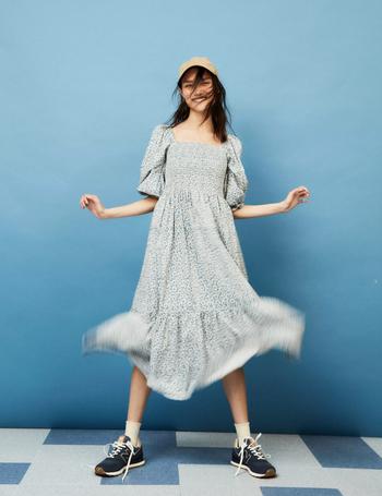 a model twirling the light blue floral dress