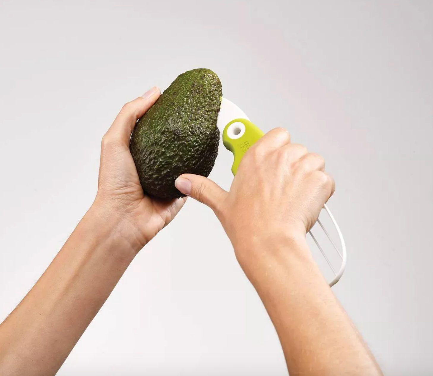 model cutting into avocado