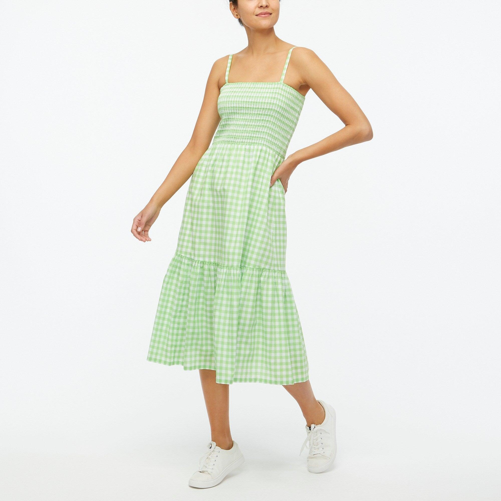 model in light green spaghetti strap dress