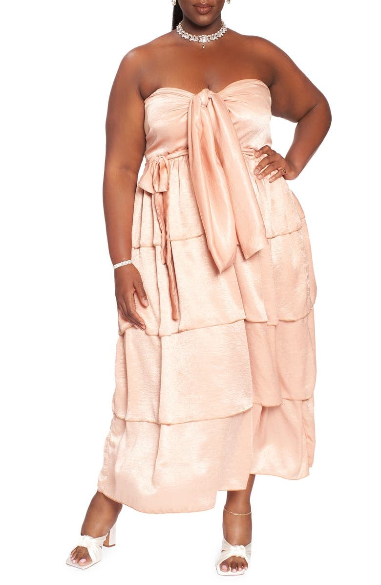 model in tan tiered strapless dress with ties at waist and bust