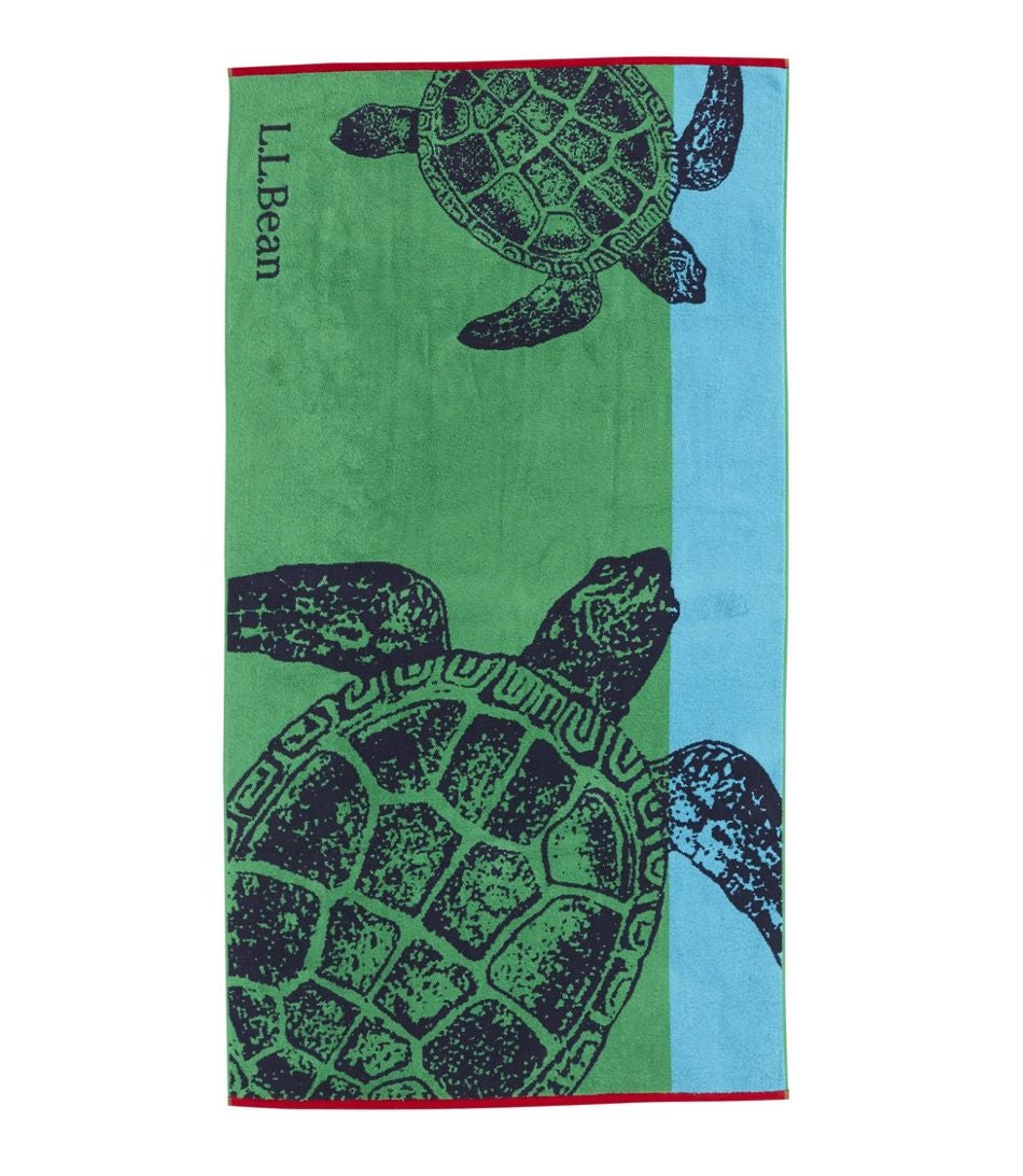 A beach towel with two sea turtles on it