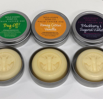 three different lotions with bee designs