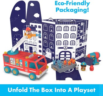 Firetruck toy with cardboard box turned into playset