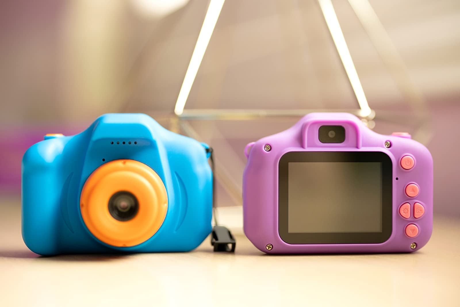 Reviewer's photo of toy cameras in blue and purple
