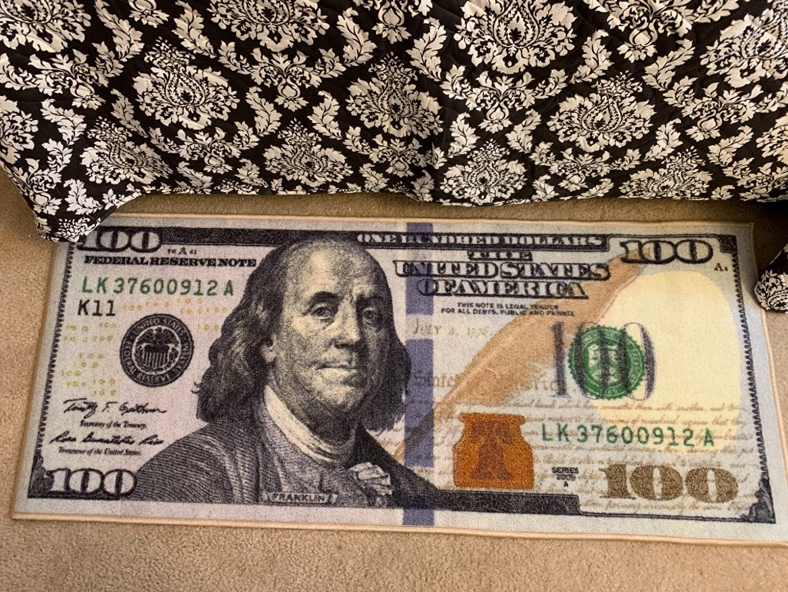 small rug shaped like a $100 bill