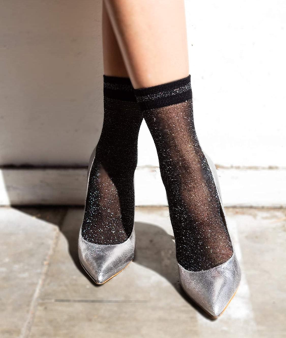the socks on a model's feet with silver metallic heels