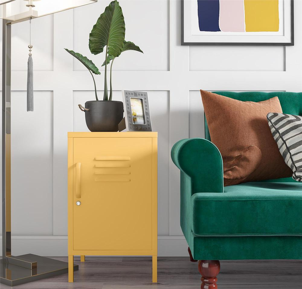 a yellow locker side table sitting next to a green couch