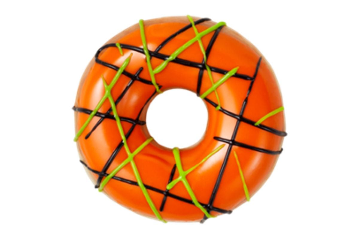 A donut with different frosting drizzled across it