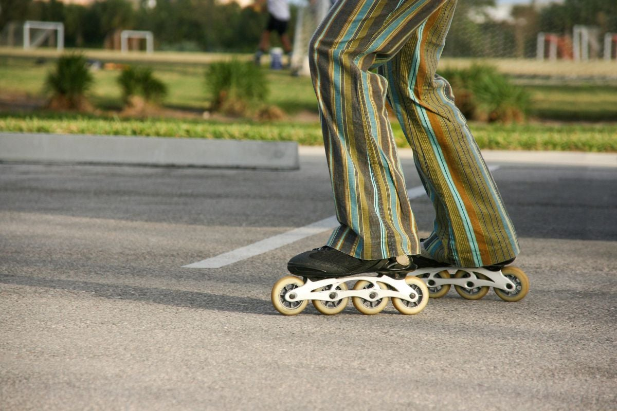 Striped bell bottoms with roller blades
