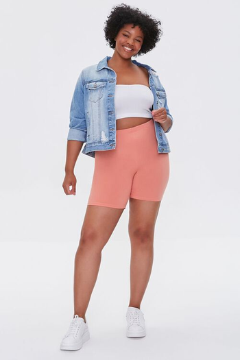 a model wearing the shorts in pink