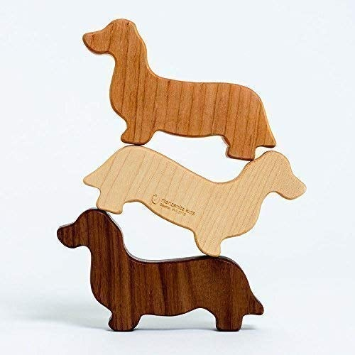 wooden rattles shaped like dogs