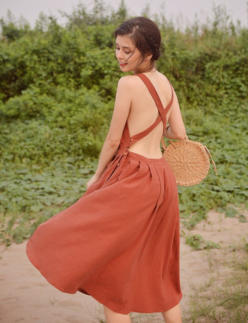 model showing off the open back with criss cross straps