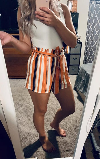 another reviewer wearing the orange and white striped version