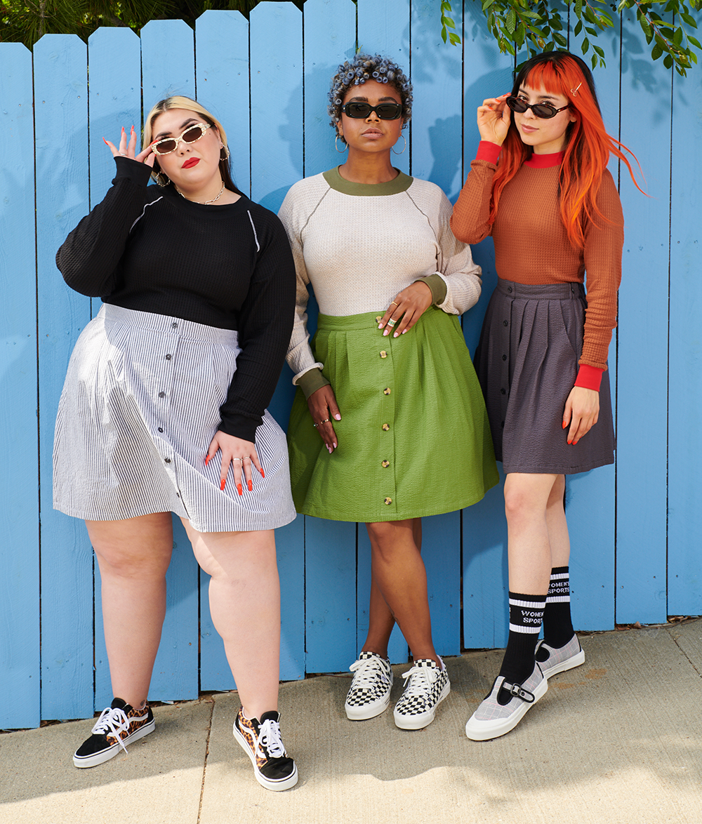 three models wearing the skirt in pinstripe, green, and gray