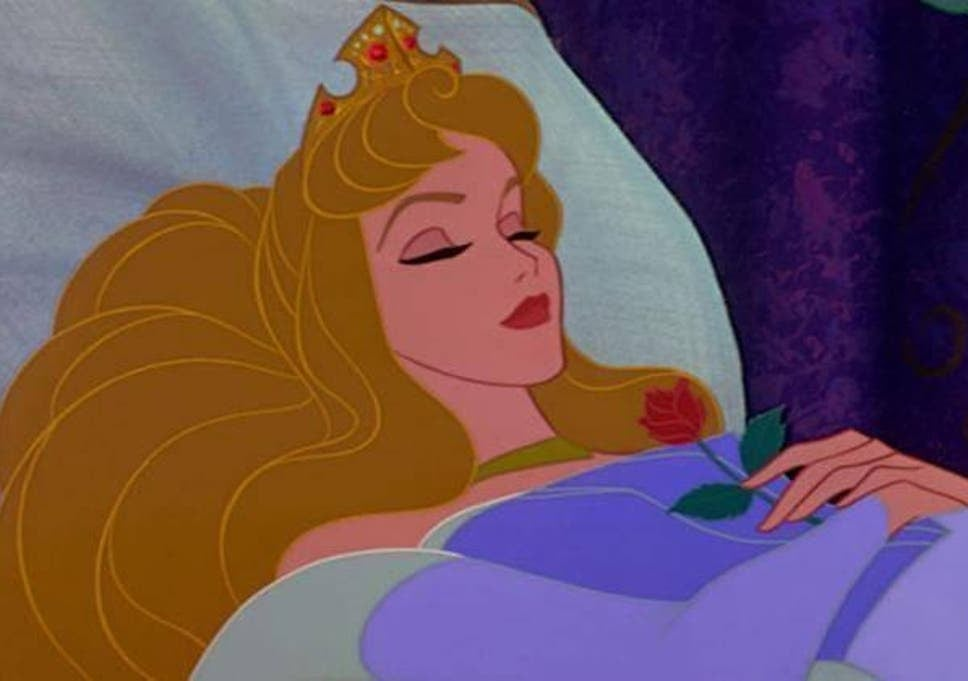 Aurora sleeps with a rose pressed to her chest