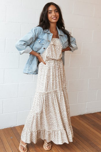 different model wearing the jacket over a maxi dress