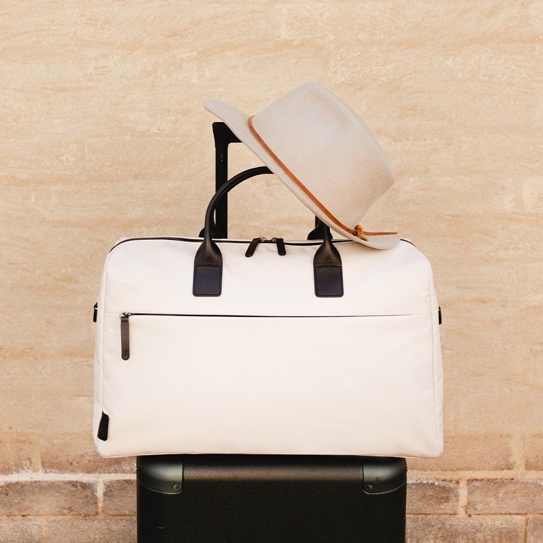 the white duffel bag