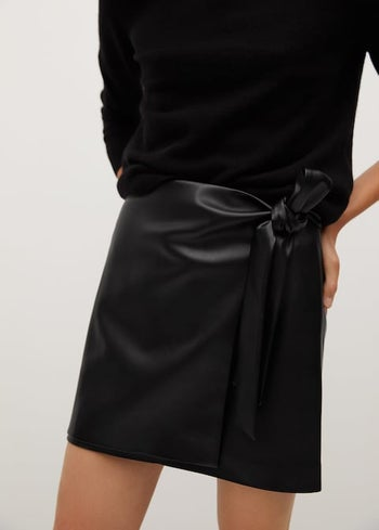 front view of a model wearing the knotted mini skirt